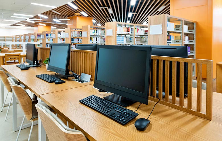Row of computers at library work station