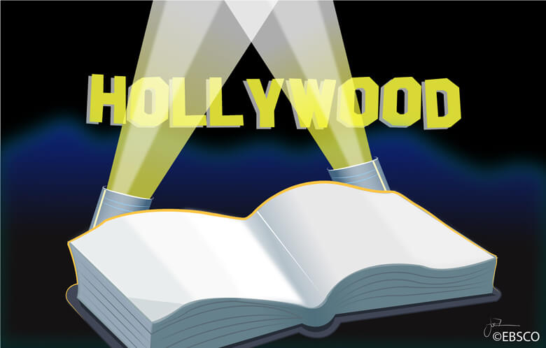 open book with spotlights shining on Hollywood