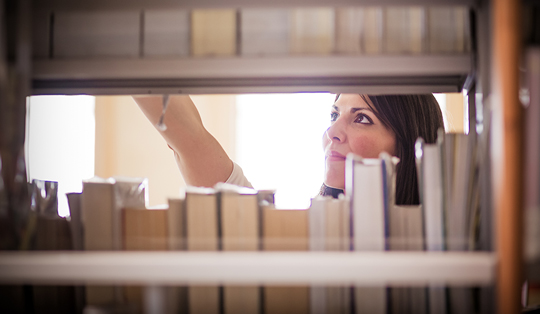 woman searching library stacks