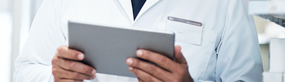 Close up of male physician holding tablet
