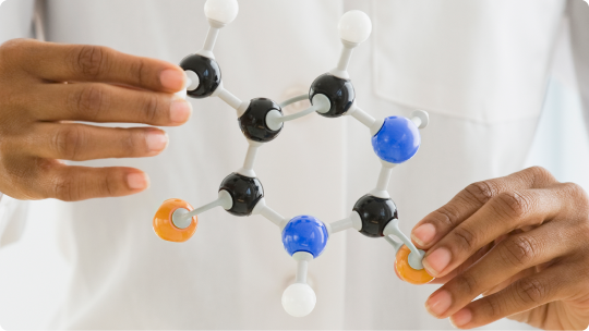 Researcher holding plastic molecules