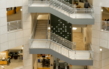 Photo capturing the beautiful interior of the library and the multi-level staircases.