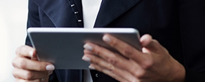 Closeup of psychologist holding tablet and reading