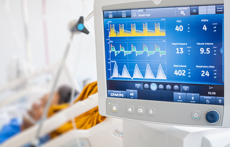 Close up of monitor showing vitals of a patient in hospital